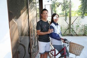 Dr Lynette Ngo (above, with husband, Dr Hing Siong Chen) suffered severe injuries when she was hit by a cab when she was cycling along Braddell Road.