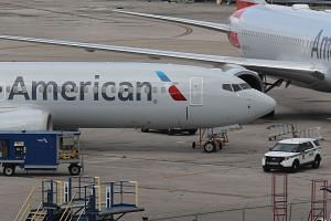 A grounded American Airlines Boeing 737 Max 8 is seen parked at Miami International Airport.