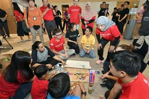 President Halimah Yacob, who is also the patron of Youth Corps Singapore, participates in activities with youth volunteers and beneficiaries at the launch of Youth Corps Service Week 2019.