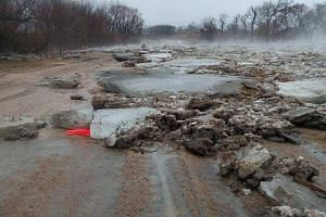 Ice blocks brought by flood waters lie on the road in Howard County, Nebraska, US, on March 13, 2019.