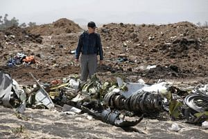 Investigators search through the debris at the scene of the Ethiopian Airlines flight ET 302 plane crash, near the town of Bishoftu, southeast of Addis Ababa, Ethiopia, on March 12, 2019.