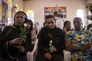 Milka Yimam (centre), who lost her 27-year-old-son Sidrak Getachew, holds a white rose during a special service for the families of the victims of the crashed Ethiopia Airlines at the Ethiopian Orthodox Church in Nairobi, Kenya, on March 17, 2019.