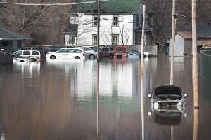 Swollen waters hit much of Nebraska, as well as parts of Iowa, Wisconsin, and South Dakota, after a major storm last week dumped snow and rain.