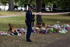 A police officer stands guard in front of the Al Noor mosque in Christchurch, New Zealand, where worshippers were gunned down.
