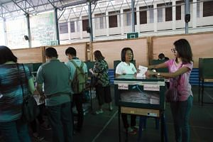 Thai voters cast their ballots during the advance voting of the general election at a polling station in Bangkok, Thailand, on March 17, 2019.