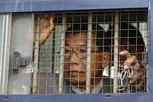 Dr. Aye Maung, Ann Township MP and former Arakan National Party leader, being escorted out of court after his hearing at Sittwe court in Sittwe, Rakhine, Myanmar, on March 19, 2019.