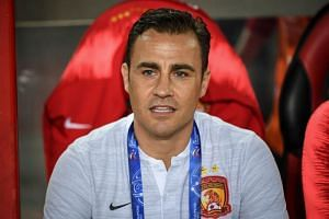 Guangzhou Evergrande's head coach Fabio Cannavaro looks on during the AFC Champions League group stage football match between China's Guangzhou Evergrande and Japan's Sanfrecce on March 5, 2019.
