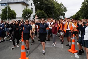 """New Zealanders ranging from heavily tattooed bikers to business executives, children and the elderly have lined up to perform the intimidating ceremonial dance which begins with fierce chants roughly translated as """"I Live! I Die!"""""""