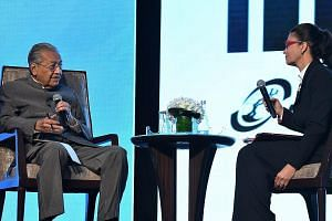 """Malaysian Prime Minister Mahathir Mohamad with Bursa Malaysia chairman Shireen Ann Zaharah Muhiudeen at Invest Malaysia 2019 yesterday. He said Malaysia remains committed to trade with all key partners, particularly nations with """"close and strongest"""