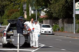 Forensic experts collect evidence near one of the attacked mosques in Christchurch, on March 16, 2019.