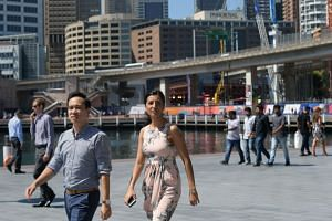 People walking in Sydney, Australia's biggest city. A ReachTel poll published in September showed that 63 per cent of Sydney residents supported curbs on migrants.