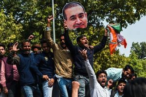 Indian supporters of the Congress Party protest against billionaire jeweller Nirav Modi in New Delhi on Feb 16, 2018. Modi is one of the main suspects charged in a US$2 billion (S$2.70 billion) loan fraud at state-run Punjab National Bank.