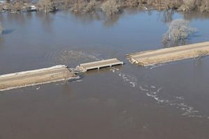 A bridge damaged by flood waters near Genoa, Nebraska, on March 18, 2019.
