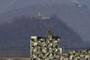 The military guard posts of South Korea (bottom) and North Korea (top) as seen from the border city of Paju on Feb 16, 2019.