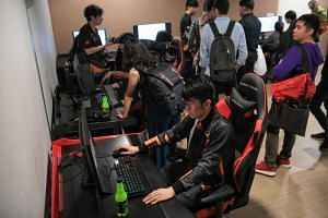 Gamers at an e-sports facility at Singapore Sports Hub's OCBC Arena on March 1, 2019.