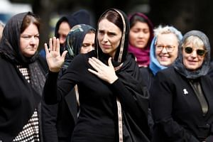 New Zealand's Prime Minister Jacinda Ardern waves as she leaves after the Friday prayers at Hagley Park outside Al-Noor mosque in Christchurch, New Zealand, on March 22, 2019.