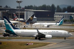 SilkAir planes at Changi Airport on March 12, 2018. The airline has six B-737 Max 8 jets in its fleet and another 31 on firm order.