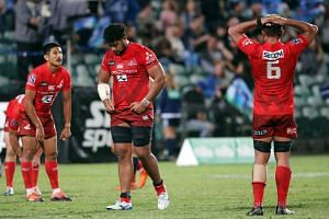 The Sunwolves' Uwe Helu (centre) and teammates look dejected after the final whistle in the Super Rugby match between New Zealand's Blues and Japan's Sunwolves at the QBE Stadium in Auckland on March 9, 2019.