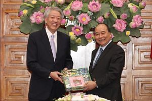 """DPM Teo posted a photograph of himself with Vietnamese Prime Minister Nguyen Xuan Phuc, who he called """"an old friend of Singapore"""", and who he said had spent some time studying economics at NUS in the early 1990s."""