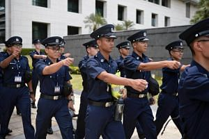 Police trainees marching out of the parade square at the Home Team Academy in a photo taken on Sept 26, 2016.