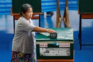 A woman casting an early vote for the upcoming Thai election at a polling station in Bangkok, Thailand, on March 17, 2019.