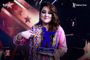 Zahra Elham, in her 20s and from Afghanistan's Hazara ethnic minority, snatched first place in a local version of American Idol.