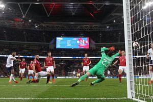 England's Raheem Sterling scores their third goal.