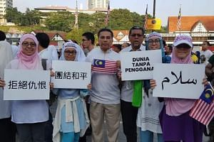 Participants in the rally carried Malaysian flags and banners promoting peace and solidarity for the victims of the Christchurch attack, on March 23, 2019.