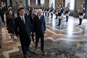 China's President Xi Jinping with Italian President Sergio Mattarella in Rome yesterday. The Chinese leader and his wife were serenaded at a state dinner last Friday by singer Andrea Bocelli. China's President Xi Jinping being welcomed by Italian Pri