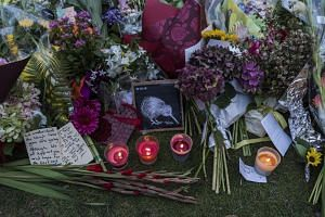 Flowers, candles and letters at a makeshift memorial honoring those killed in the mass shootings at two mosques in Christchurch, New Zealand, on March 17, 2019.