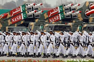 Pakistan Navy soldiers marching past Nasr tactical ballistic missile system vehicles during the Pakistan Day parade in Islamabad on March 23, 2019.