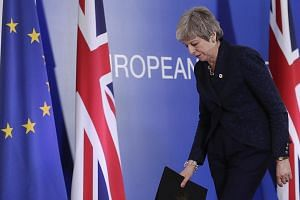 British Prime Minister Theresa May leaving at the end of the Article 50 session at the European Council in Brussels, Belgium, on Thursday. According to reports by the British media, Mrs May could be replaced by an interim leader who would lead Britai