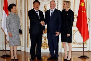 Prince Albert II of Monaco and his wife, Princess Charlene, welcoming Chinese President Xi Jinping and his wife, Ms Peng Liyuan, at the Monaco Palace yesterday. Mr Xi will meet French President Emmanuel Macron today.