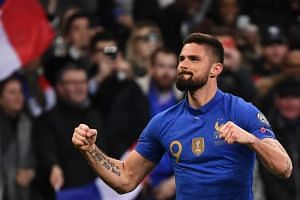 France's forward Olivier Giroud celebrates after scoring the 2-0 goal during the UEFA Euro 2020 Group H qualification football match between France and Iceland at the Stade de France stadium in Saint-Denis, north of Paris, on March 25, 2019.