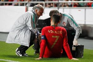 Portugal's Cristiano Ronaldo receives treatment from medical staff.