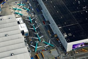An aerial photo of Boeing 737 Max airplanes parked on the tarmac at the Boeing factory in Renton, Washington. Two crashes in five months, involving the Boeing 737 Max 8, have raised serious concerns and questions about how planes are made and certifi