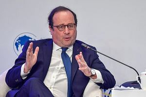 Former French president Francois Hollande speaking at the Boao Forum for Asia in south China's Hainan province.
