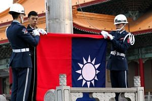 Soldiers hoisting Taiwan's national flag at the Liberty Square in Taipei, Taiwan, on March 13, 2019.