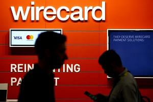 Lawyers hired by Wirecard AG found no evidence of corruption and said there will be no material impact on the business's financial statements from wrongful accounting