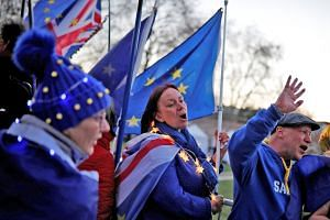 Anti-Brexit demonstrators outside the Houses of Parliament in London on Monday. Nearly three years after the 2016 EU membership referendum, and three days before Britain was supposed to leave the bloc, it remains unclear how, when or even if Brexit w