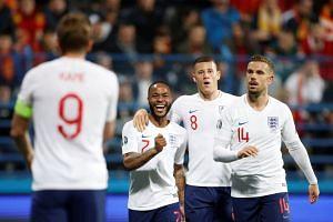 England's Harry Kane celebrates scoring their fourth goal with Raheem Sterling, Ross Barkley and Jordan Henderson.