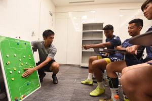 Tampines Rovers' head coach-in-waiting Gavin Lee talking tactics with his players on March 28, 2019, the day before their Singapore Premier League game against Albirex Niigata.