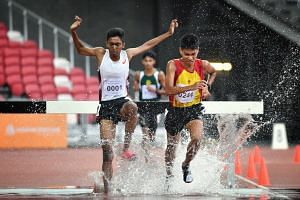 Anderson Serangoon Junior College's Ruben Loganathan (left) and Hwa Chong Institution's Joshua Rajendran came in first and second respectively in the Schools Nationals A Division boys' 3,000m steeplechase final on March 28, 2019.