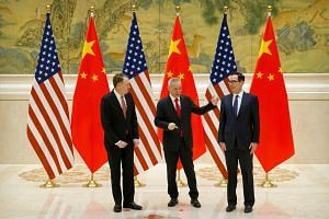(From left) US Trade Representative Robert Lighthizer, Chinese Vice-Premier Liu He and US Treasury Secretary Steven Mnuchin at trade talks in Beijing last month. Bilateral trade talks are expected to continue this week, as Mr Lighthizer and Mr Mnuchi
