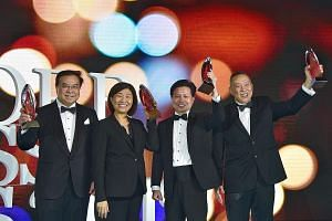 (From left) OCBC Bank chief executive officer Samuel Tsien, GGV Capital managing partner Jenny Lee, Centurion Corporation CEO Kong Chee Min and Sheng Siong supermarket founder and CEO Lim Hock Chee with their awards yesterday at the Singapore Busines