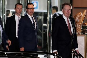 US Treasury Secretary Steven Mnuchin (middle) and US Trade Representative Robert Lighthizer (right) arriving in Beijing yesterday for a new round of trade talks. The duo and China's top economic official Liu He have