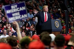 "US President Donald Trump, speaking to a crowd of thousands at a Grand Rapids arena on Thursday, called his opponents ""losers"" and celebrated the fact that the Russia collusion probe had come to a close."