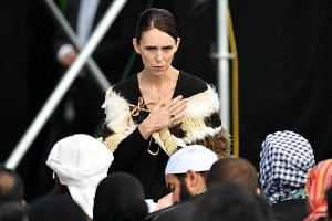 New Zealand's PM Jacinda Ardern greets family members of the Christchurch mosque victims during a national remembrance ceremony, on March 29, 2019.