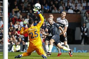 Manchester City's Sergio Aguero scores their second goal during their English Premier League match between against Fulham at Craven Cottage in London on March 30, 2019.