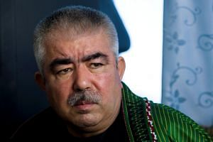 Abdul Rashid Dostum speaks during an interview with Reuters in a 2009 file photo.